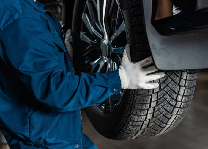 cropped-view-of-mechanic-installing-new-tire-on-car-1.jpg